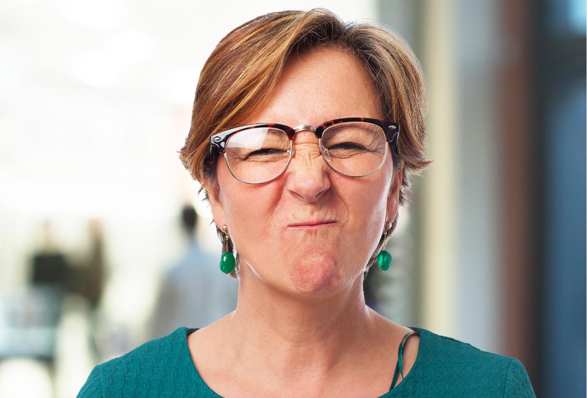portrait of a mature woman doing a funny grimace
