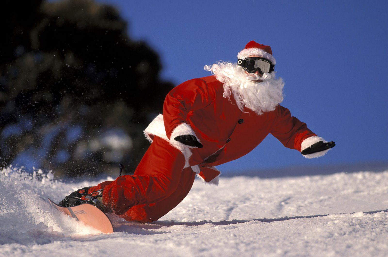 Santa snowboarding during Christmas Week